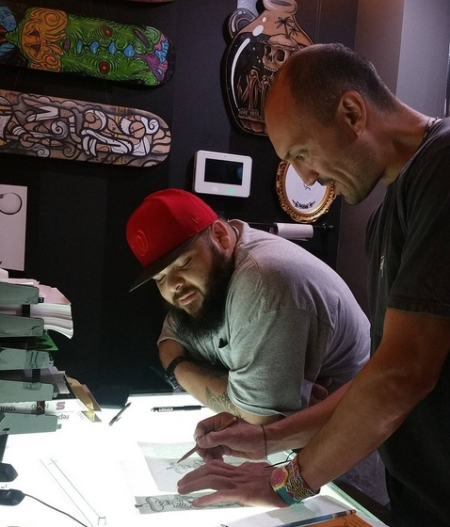 Berto and Rico Mas Paz working on a piece at the drawing table